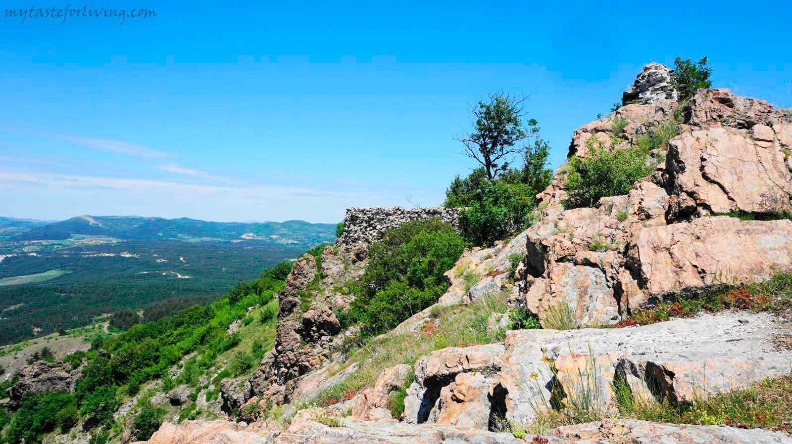 The medieval fortress and peak Monyak (Monek) are located about 11 km from the town of Kardzhali, Bulgaria, near the village of Shiroko Pole, above the dam Studen Kladenets.