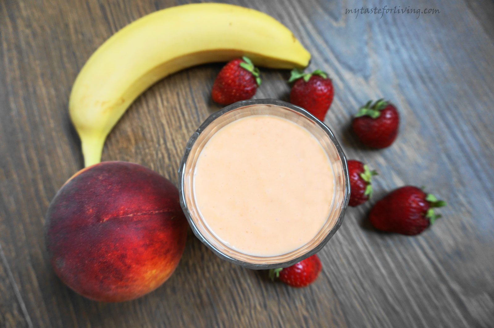 Delicious and fresh smoothie prepared with peach, banana, strawberries, honey, yogurt and coconut oil.
