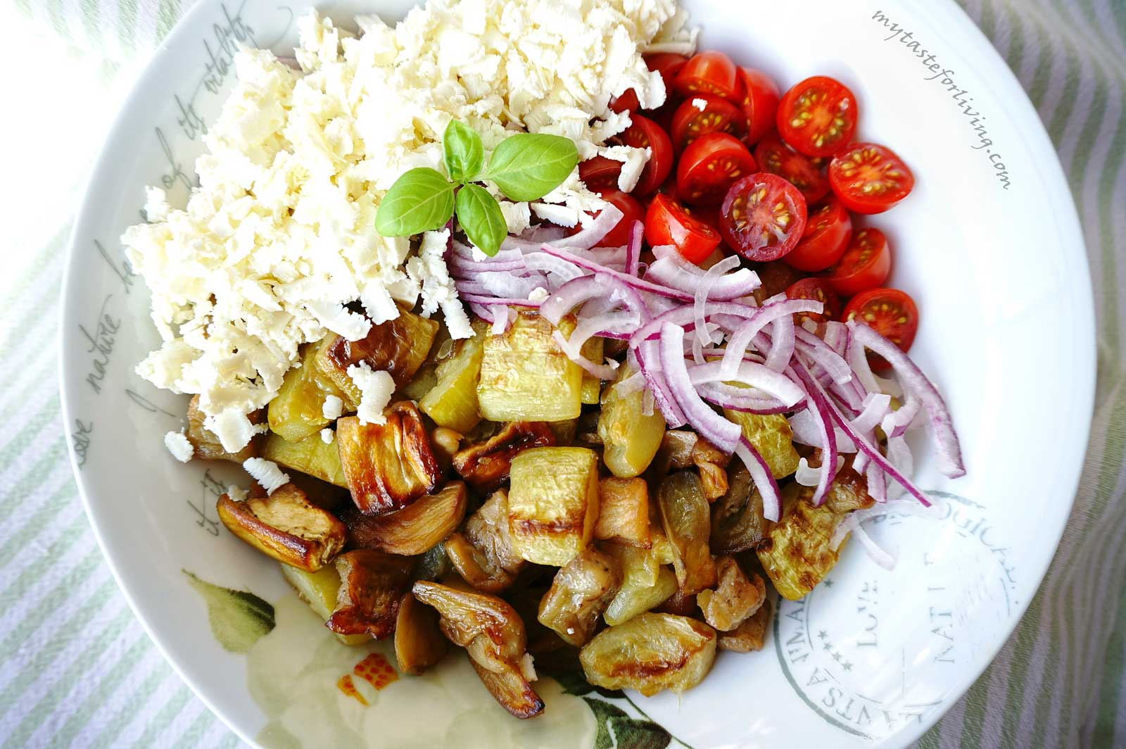 Roasted zucchini and eggplant salad with cherry tomatoes, red onion and feta cheese.