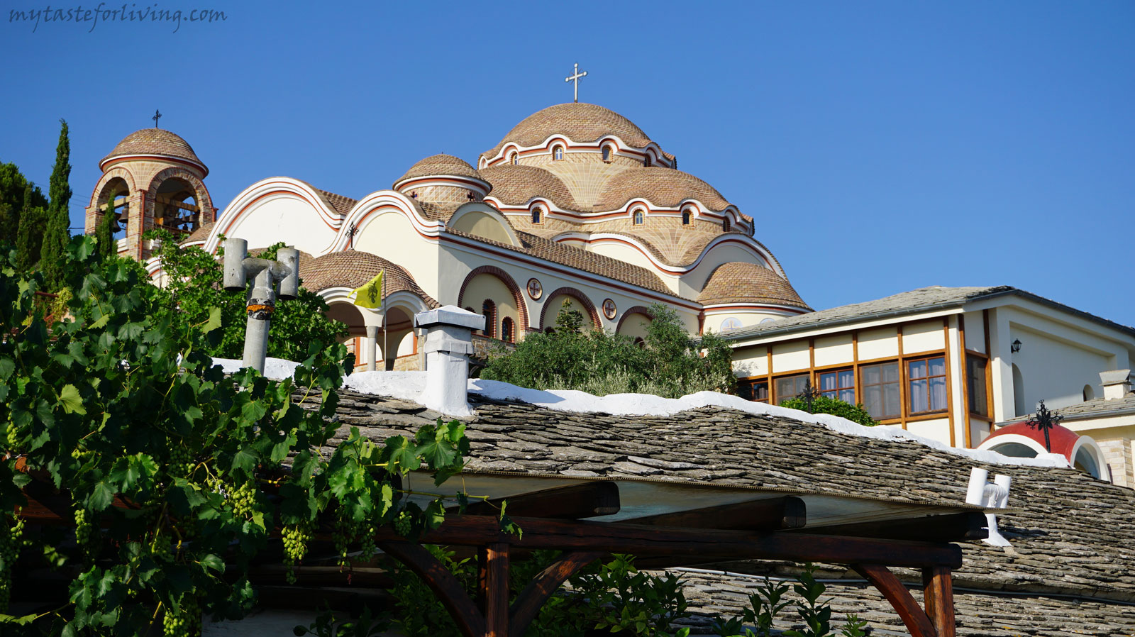 "Monastery ""St. Archangel Michael"" is built on the top of 250 meters high cliff above the sea shore, near the village of Theologos and is the largest and most popular monastery of Thassos, Greece."