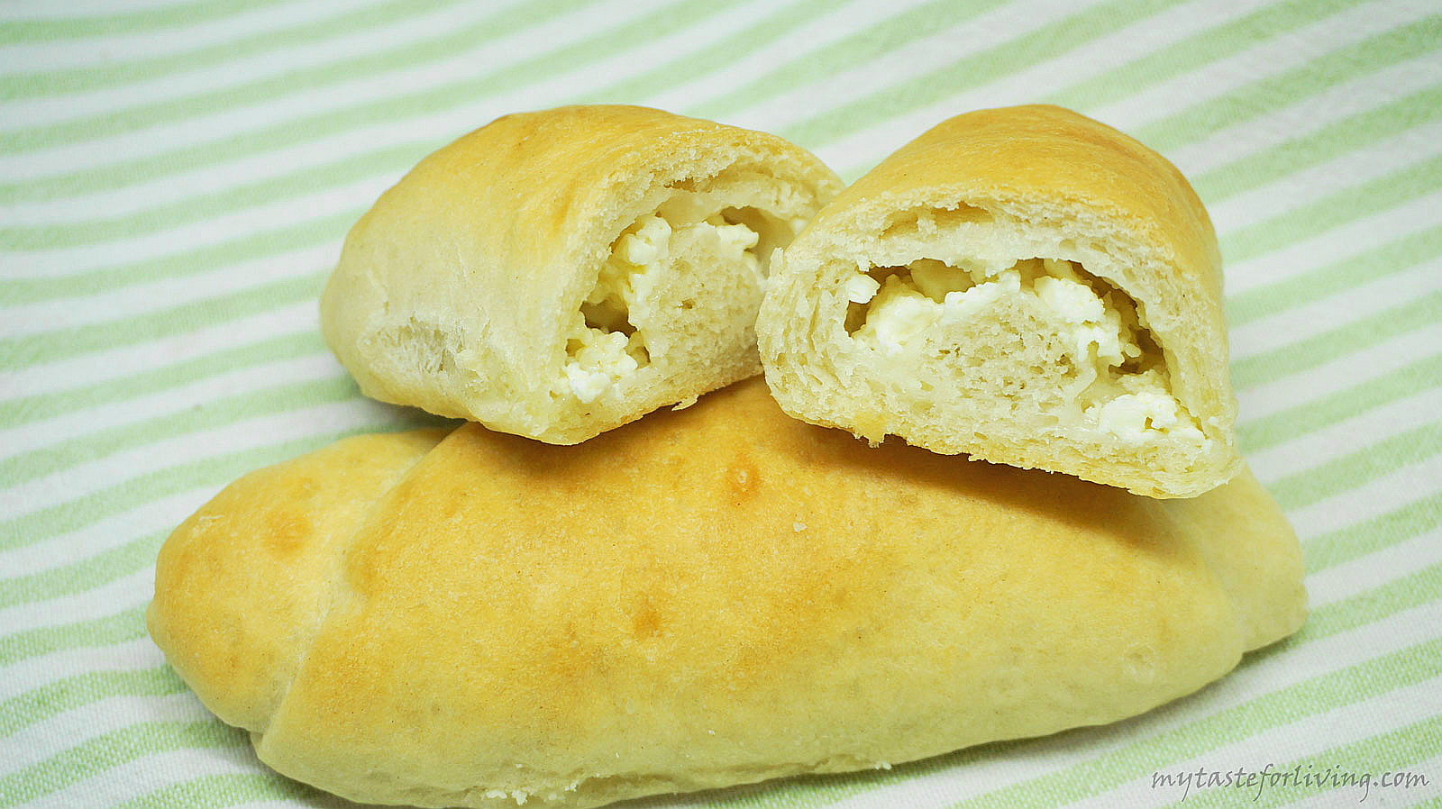 Delicious and soft bread rolls with butter and cheese, suitable for breakfast.