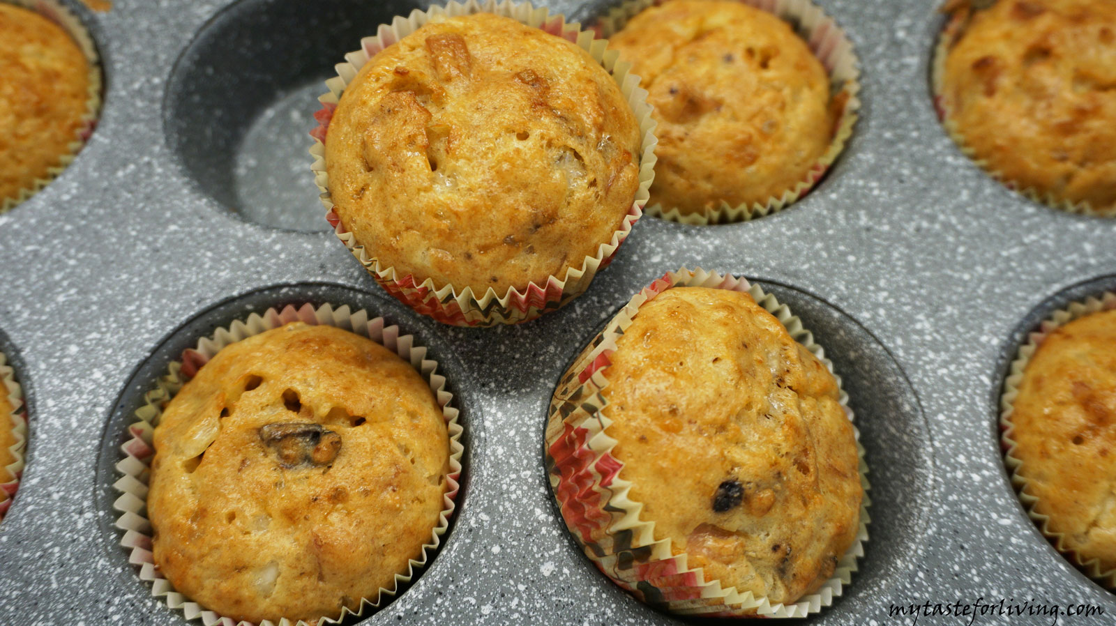 Delicious einkorn muffins with cottage cheese, yellow cheese, white cheese and olives.